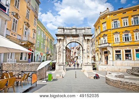 Golden Roman Gate (Sergius Arch) in Pula at sunhy day, Croatia
