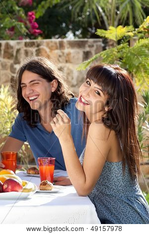 Happy Young Couple Dining Outdoors