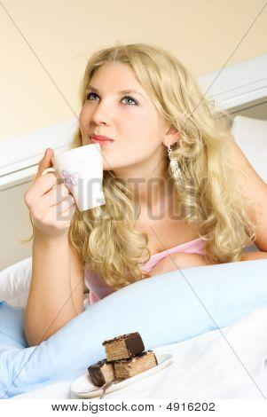 Dreamy Girl Drinking Coffee