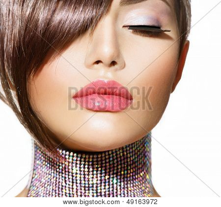 Hairstyle. Fringe. Haircut. Beauty Model Girl Portrait with Perfect Makeup. Healthy Smooth Skin. Make up. Accessories