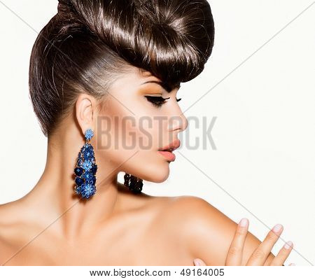 Fashion Model Girl Portrait with Blue Earrings. Creative Hairstyle. Hairdo. Make up. Beauty Woman isolated on a White Background