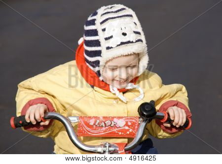 Three-year Child Riding On A Bicycle