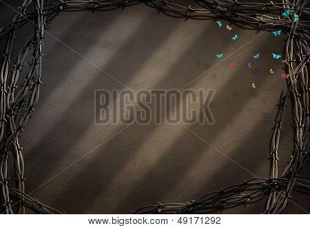 Marco de púa con pequeñas mariposas