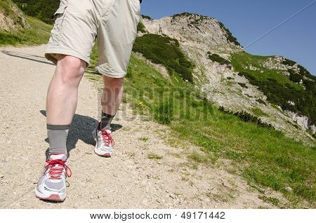 Man On A Hiking Trail In The Tirolean Mountains