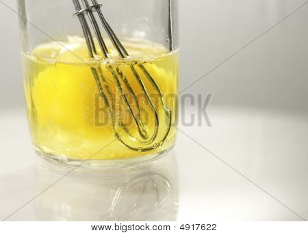 Whisk And Egg In Glass Jar