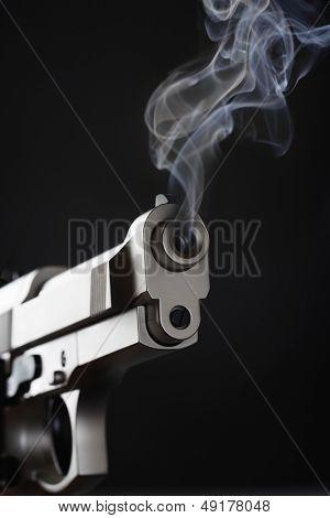 Smoking Handgun against black background