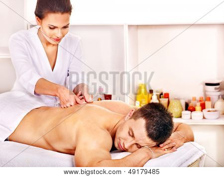 Man getting relaxing massage in spa.