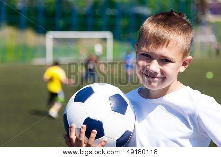 Boy soccer player at the stadium.