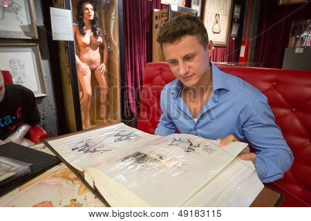 MOSCOW - JAN 24: A man looks album in Museum-Shop Point G on Novy Arbat on January 24, 2013 in Moscow, Russia.