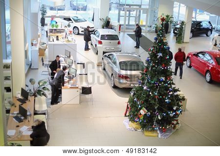 MOSCOW - JAN 11: Top view of the foyer with a reception and cars of Volkswagen Center Varshavka January 11, 2013, Moscow, Russia. Building of the center contains a three floor