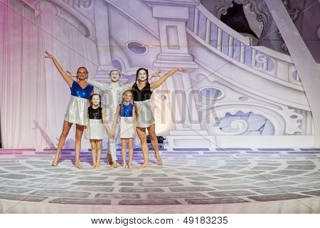 MOSCOW - JAN 5: Group portrait of goodies of musical spectacle for children Through the Looking Glass in Swimming Pool of Sports complex Olympyisky after performance, January 5, 2013, Moscow, Russia.