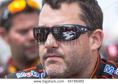 LOMG POND, PA - AUG 04, 2013:  Tony Stewart (14) takes to the track for the GoBowling.com 400 race at the Pocono Raceway in Long Pond, PA on Aug 4, 2013.