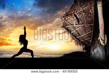 Yoga Silhouette Warrior Pose Near Boat