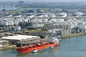 stock photo of silos  - Oil tanker moored at a oil storage terminal - JPG