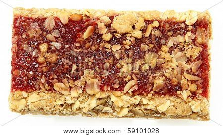 Individual strawberry granola bar shot from top over veiw on white.