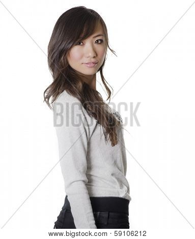 Beautiful young woman turning head around isolated against white background