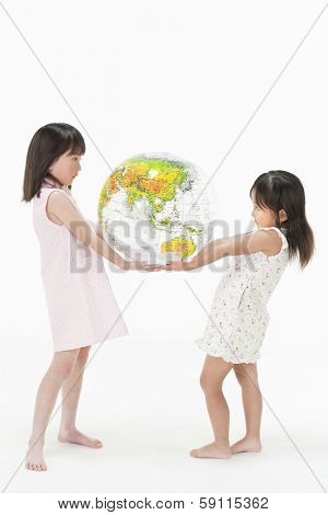 Children having a terrestrial globe