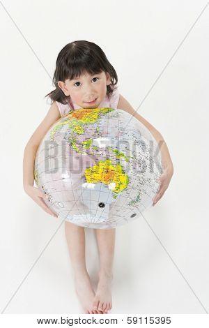 Child having a terrestrial globe