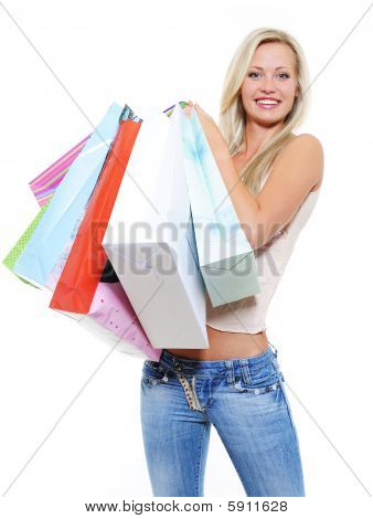 Hermosa mujer bonita con muchas compras