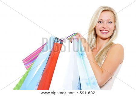 Attractive Laughing Blond Woman Present Shopping Bags