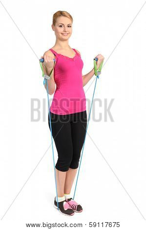 Young blond girl doing female biceps exercise using rubber resistance band. position 2 of 2.
