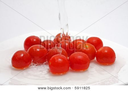 Tomatos And Water On White Background