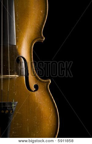 Close Up Of Old Violin Isolated On Black