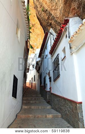 view of street between the rocks in Setenil de las Bodegas, Cadiz ,Spain