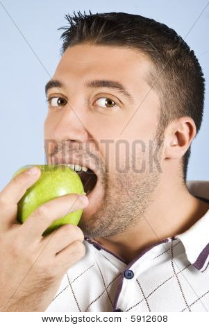 Male Portrait Taking A Bite Of An Apple