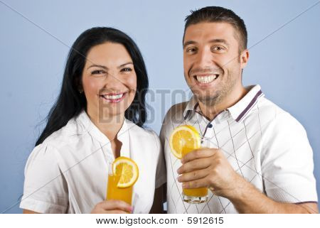 Extremely Happy Couple With Orange Juice