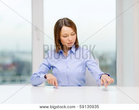 business, education and technology concept - smiling woman pointing to something or pressing imaginary button