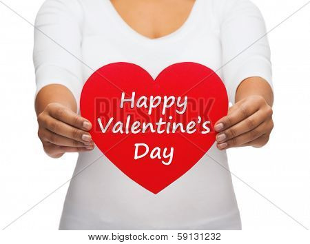 love and relationships concept - closeup of woman hands with heart and happy valentines day message