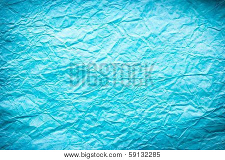 Texture of crumpled blue paper.