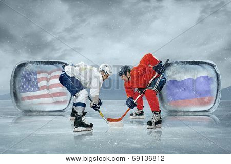 Ice hockey players in the ice. Game between USA and Russia
