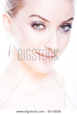 closeup portrait of fresh and smiling attrctive young woman