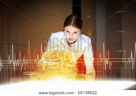 Image of young woman doctor. Concept of modern technology