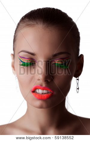 Face of beautiful girl with bright UV makeup