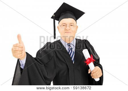 Mature man in graduation gown holding a diploma and giving thumb up isolated on white background