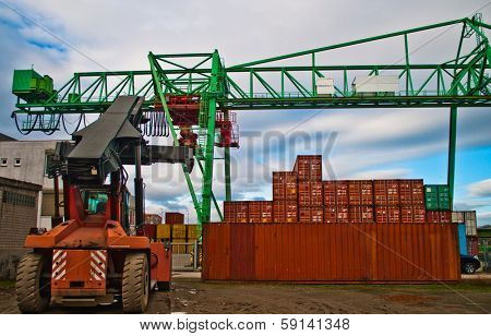 Cranes and cargo container on a storage site
