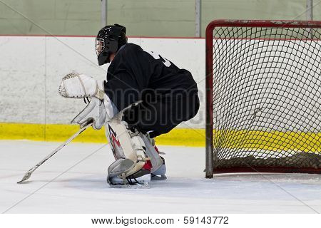 Goalie In His Net During An Ice Hockey Game
