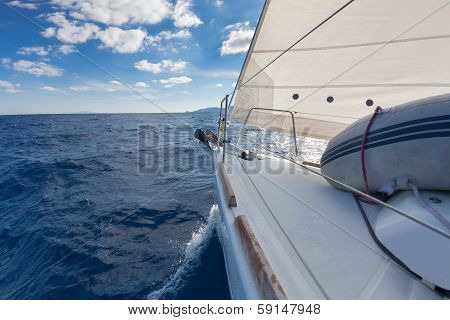 Anchor And Furling Drum On The Yacht Bow In Sea