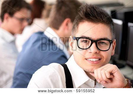 Smart highschool student with glasses posing