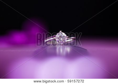 White Gold Ring with Diamonds on colored background