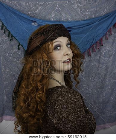 Beautifiul young woman dressed as a gypsy
