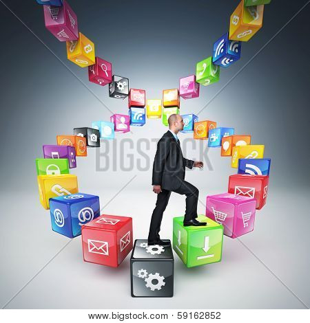 businessman on abstract icons cubes