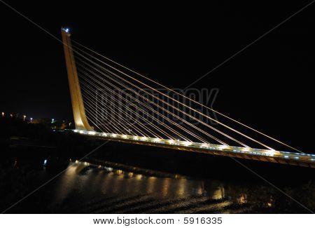 Modern suspension bridge over Guadalquivir Seville Spain