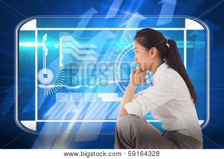 Businesswoman sitting cross legged with hands together against futuristic shiny arrow pointing upwards