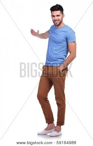 full body picture of a young casual man presenting something onwhite background
