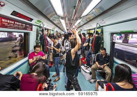 HONG KONG, CHINA - OCTOBER 14, 2012: Passengers ride the subway in Hong Kong. The MTR consists of 218.2 km of rail with 152 stations.