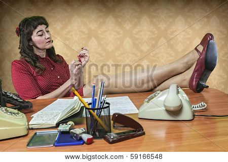 Young Secretary With A Nail File In The Office, 1960's Scene